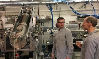 "On March 28, 2017, we saw ""first light"" at our new IRIXS spectrometer at the PETRA-III synchrotron in Hamburg. IRIXS stands for ""Intermediate-energy Resonant Inelastic X-ray Scattering"", a method that will allow energy- and momentum-resolved measurements of electronic modes in quantum materials with 4d valence electrons. The construction of the unique instrument is made possible by an Advanced Grant from the European Research Council. The photo shows Hlynur Gretarsson sharing a drink to celebrate this event with Markus Tischer, whose group designed the undulators that supply photons to the spectrometer.  See also the time lapse video of him, Simon Mayer, Hasan Yavas and others assembling the spectrometer."