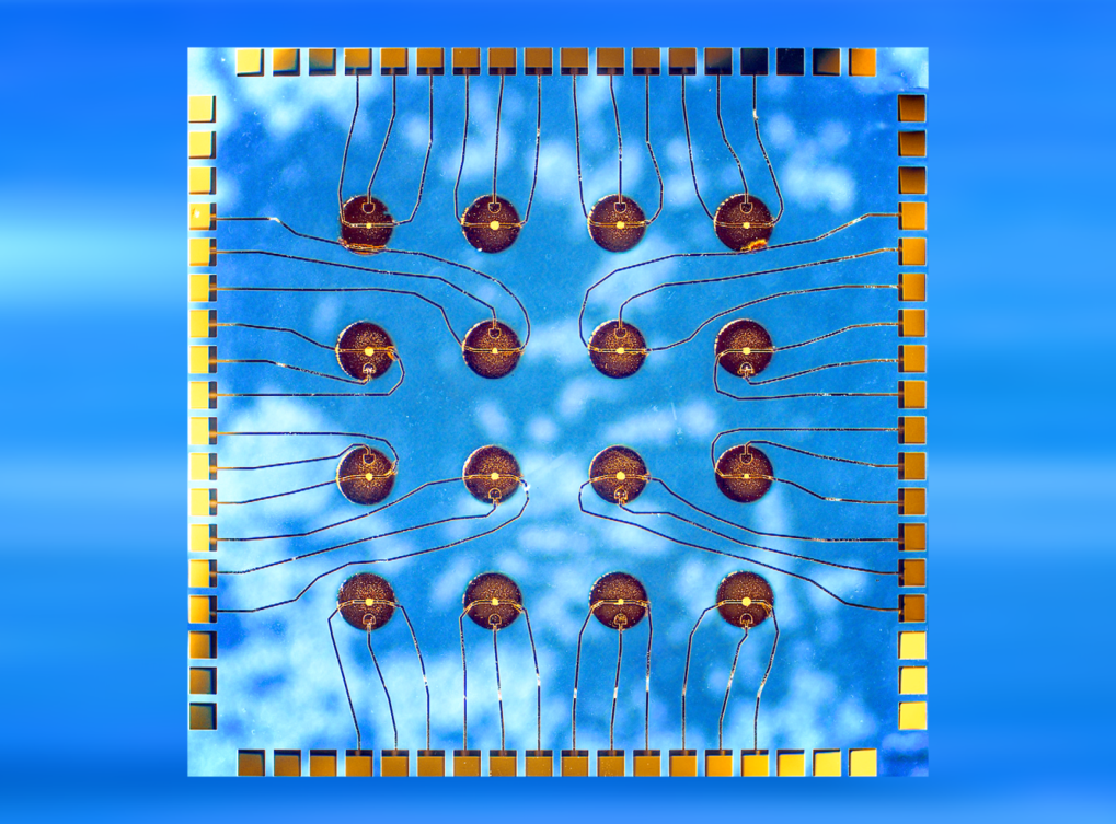 Photo of a chip containing 16 field-effect transistors with integrated micropatterned liquids serving as gate dielectrics.   Advanced Materials 30, 1802598 (2018)